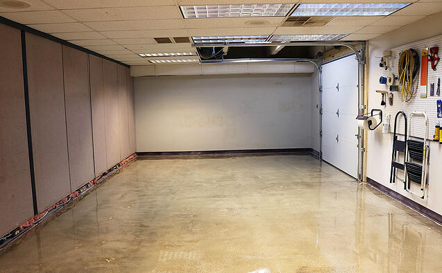 New epoxy floors and garage door for medical cart testing room